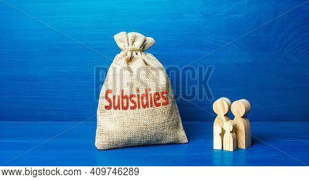 Family Figurines And Subsidies Money Bag. Financial Support In Paying Bills. Providing Tax Breaks, L