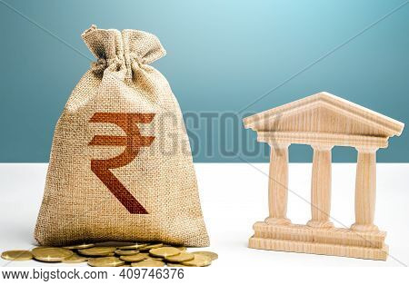 Indian Rupee Money Bag And Bank / Government Building. Budgeting, National Financial System. Resourc
