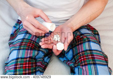 Man Pouring Pills From A Bottle Into His Hand. Taking Vitamins, Supplements, Antibiotic, Antidepress