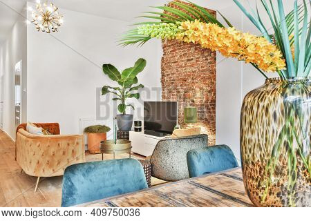 Living Room With Carpet, Mild Sofa, Table, And Other Luxury Furniture