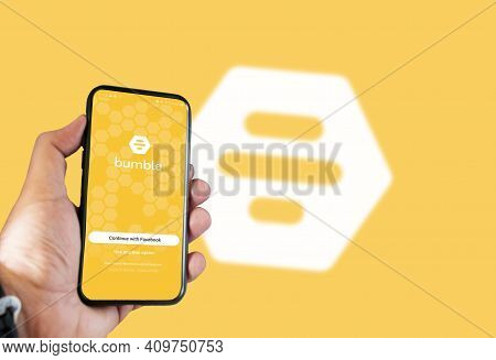 Rome, Italy, February 16th 2021: Hand Holding A Smart Phone With Bumble Dating App Login Page On Scr