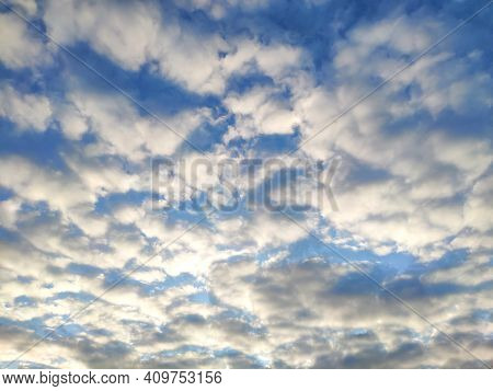 The Sun Shines On The Clouds In The Sky. Blue Sky With Clouds Background.