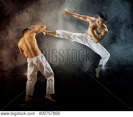 Two martial arts masters, karate practice. On black background. Two image of the same model