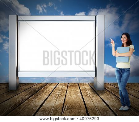 Student woman near blank billboard. Advertising concept.