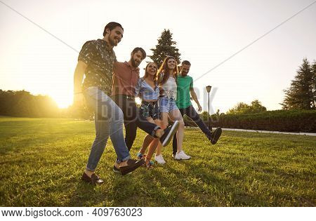 Group Of Young Hipster Friends Having Fun And Dancing In Countryside Summer .