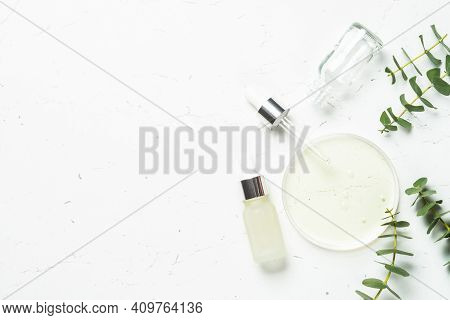Essential Oil, Eucalyptus Oil . Glass Petri Dish With Essential Oil At White Background.
