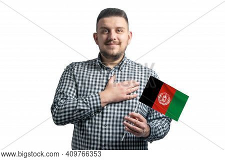 White Guy Holding A Flag Of Afghanistan And Holds His Hand On His Heart Isolated On A White Backgrou