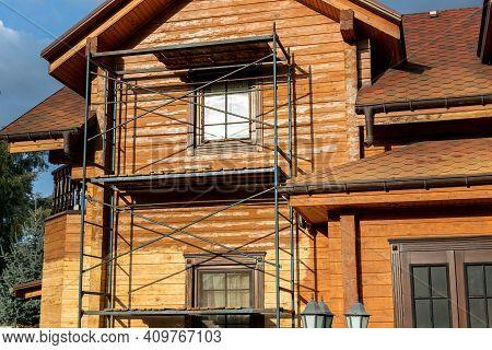 Modern Wooden Timber Eco House Villa Facade During Process Of Renovation, Sanding Wall For Varnishin