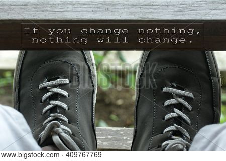 If You Change Nothing, Nothing Will Change. Inspirational Words Concept On Wood And Man Feet With Sn