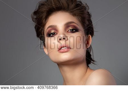Portrait Of Beautiful Woman With Romantic Red And Gold Smokey Eyes Makeup