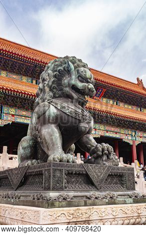 Beijing, China - April 27, 2010: Forbidden City. Closeup Of Giant Black-green Statue Of Lion In Fron