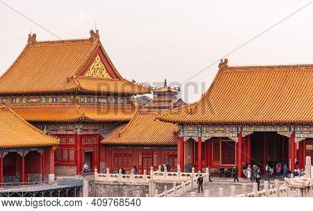 Beijing, China - April 27, 2010: Forbidden City. Red-gold-orange Building Group On Side Of Supreme H