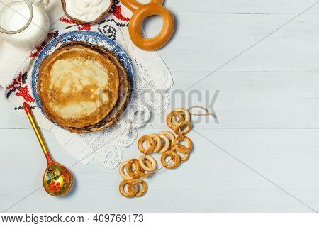 Maslenitsa,pancakes, Dries, And Bagels. Traditional Dishes Of Russian Cuisine Pancake Day. Layout On
