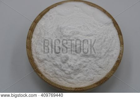 Wooden Bowl Of Baking Soda On Background.