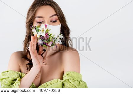 Woman In Blouse With Naked Shoulders And Medical Mask With Flowers Isolated On Grey.