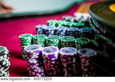 Casino Chips Colorful Gaming Pieces Lie On The Game Table In The Stack. Background For Gambling , Ca