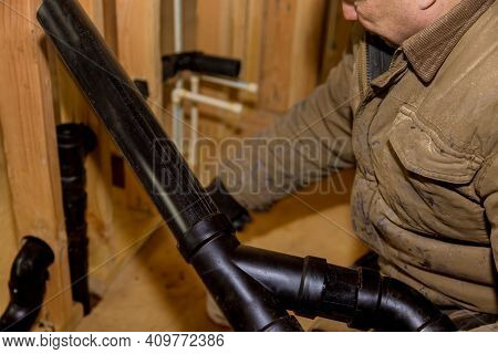 Plumbing Building Contractor Installing Plastic Drain Pipe In The Elbow For Drain Laundry Outlet Box