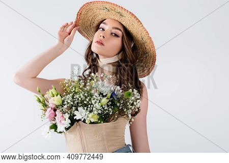 Fashionable Model Posing With Flowers In Blouse Isolated On Grey.