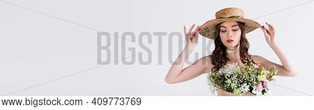 Model Holding Sun Hat While Hosing With Flowers In Blouse Isolated On Grey, Banner.