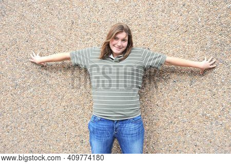 Plus Size Female Beauty Fashion Model Expressions Against A Wall Outside.