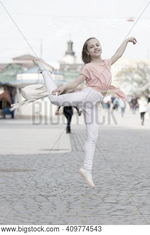 The Dancer Is At Her Best. Adorable Street Dancer. Little Female Dancer Performing Ballet Leap On St