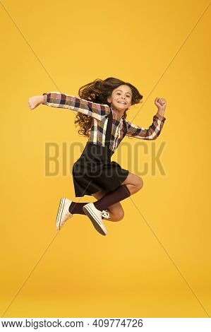 Free Style. Happy Schoolchild In Midair Yellow Background. Free From School. Summer Holidays. Free T