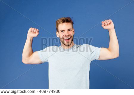 Strong And Full Of Energy. Man Strong Handsome Unshaven Guy On Violet Background. Masculinity Concep