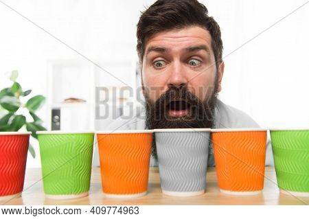 Curious Man Looks On Colorful Coffee Cups. Color Your Day. Different Types Of Coffee Drinks In Cafe