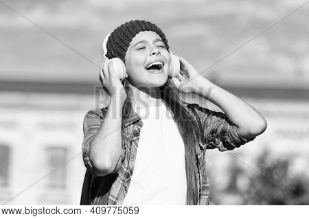 Dont Compromise On Sound. Happy Child Listen To Music With Closed Eyes. Hi-fi Stereo Sound. Music An