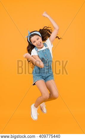 Energy Inside. Feeling Free. Carefree Kid. Summer Holidays. Jump Of Happiness. Small Girl Jump Yello