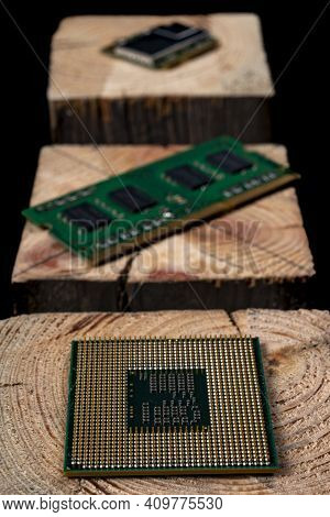Processor And Ram Memory From A Personal Computer Stacked On Raw Wood. Accessories And Spare Parts F