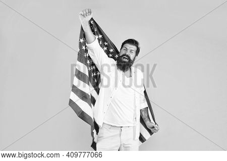 Becoming American Citizen. Happy Hipster Celebrate Independence Day. Bearded Man Hold American Flag