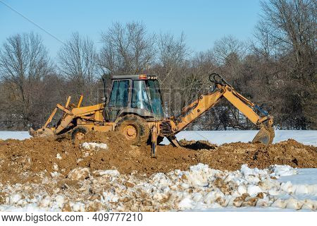 Tractor Digging The Ground Under The Foundation Heavy