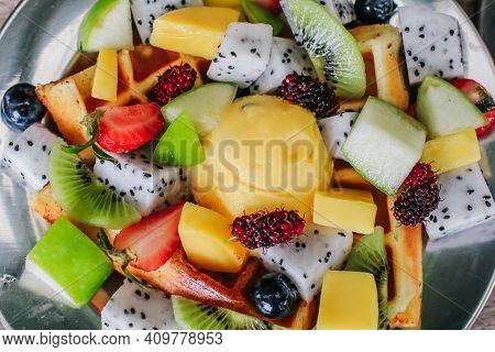 Bowl Of Healthy Salad From Fresh Fruit Table. Mixed Fresh Fruit (strawberries, Orange, Blueberries,