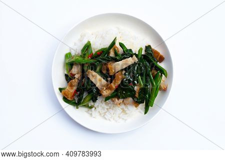Stir Fried Chinese Kale With Crispy Pork Belly With Rice On White