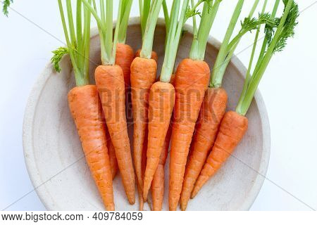 Fresh Carrots On White Background. Top View