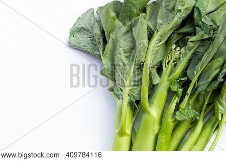 Chinese Kale Or Kailaan Or Hong Kong Kale On White Background.