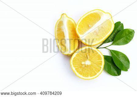 Fresh Lemon With Green Leaves On White Background.
