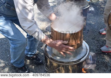 How To Make Japanese Traditional Rice Cakes (mochi-tuki) Is Mortar.many Times Pounding With A Mallet