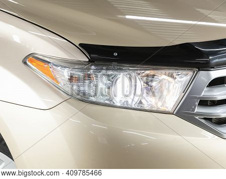 Novosibirsk, Russia - February 22 2021:  Toyota Highlander, Headlight Of A Modern Popular Car Close-