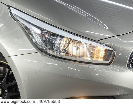 Novosibirsk, Russia - February 22 2021:  Kia Ceed, Headlight Of A Modern Popular Car Close-up. Shiny