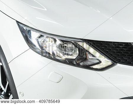 Novosibirsk, Russia - February 22 2021:  Nissan Qashqai, Headlight Of A Modern Popular Car Close-up.