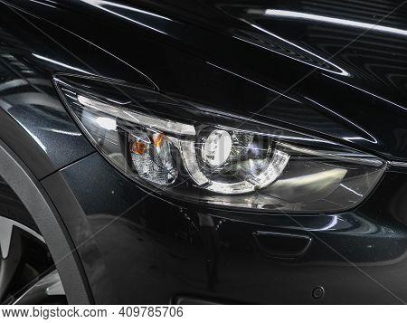Novosibirsk, Russia - February 22 2021:  Mazda Cx-5, Headlight Of A Modern Popular Car Close-up. Shi