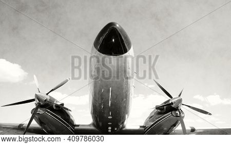 Old Propeller Airplane Closeup Nose View Black And Ehite