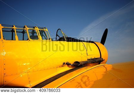 Retro Yellow Airplane Nose View Against Blue Sky