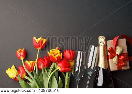 St. Valentine, Wedding, Birthday Or Mother's Day. Beautiful Red Yellow Tulips, Wine Glasses, Bottle