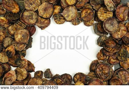 Natural Treats For Pets. Dried Dried Bovine Testicles With The Blank White Area. Full Frame Of Dried