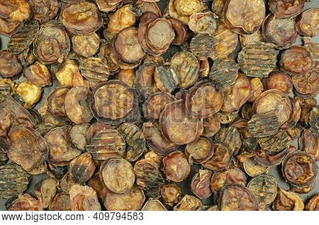 Helpful Treats For Pets. Pieces Of Dried Bovine Testicles. Full Frame Of Dried Treat Pieces. Beef Je