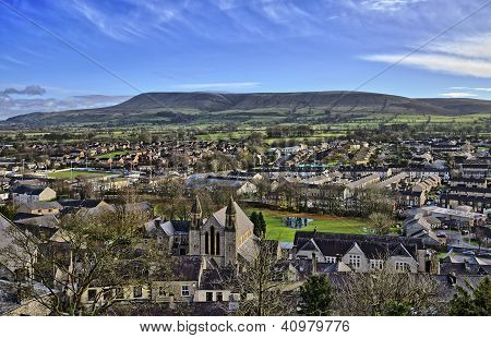 View across Clitheroe, a Lancashire town of Saxon origin, looking towards Pendle Hill, a plateau of Pendle Grit;a coarse carboniferous sandstone, overlaying carboniferous limestone with slopes of boulder clay. poster