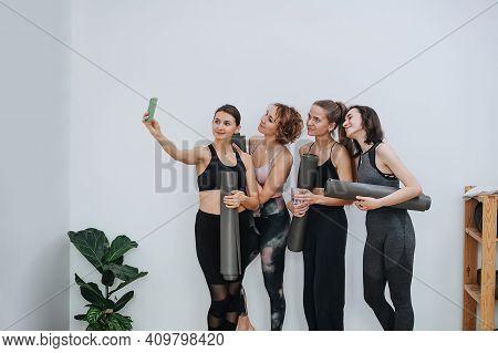 Young Friendly Women Socialising At Yoga Club, Taking Selfie